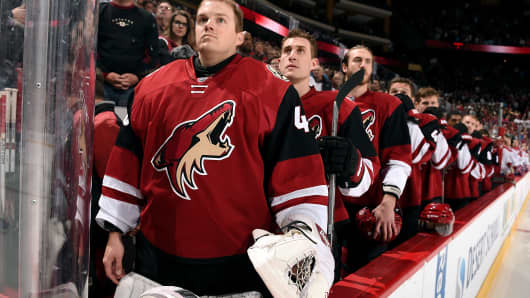 Goalie Nathan Schoenfeld #40 of the Arizona Coyotes stands for the national anthem before the start of a game against the Montreal Canadiens at Gila River Arena on February 15, 2016 in Glendale, Arizona. Schoenfeld was an emergency call up after back-up goalie Anders Lindback was injured on Monday before the game.