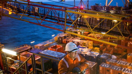 A worker looks out onto the weather deck of the Armada gas condensate platform, operated by BG Group Plc, in the North Sea, off the coast of Aberdeen, U.K.