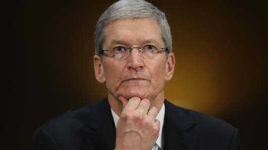 Apple CEO Timothy Cook delivers pauses while giving opening remarks while testifying before the Senate Homeland Security and Governmental Affairs Committee's Investigations Subcommittee about the company's offshore profit shifting and tax avoidance in the Dirksen Senate Office Building on Capitol Hill May 21, 2013 in Washington, DC.