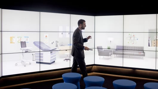 Fredrik Tunvall, a senior client engagement leader at IBM Watson, goes through a demonstration in the Immersion Room. IBM to acquire Truven Health Analytics for $2.6 billion.