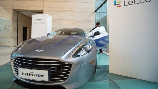 Aston Martin's RapidE concept vehicle following the announcement of a joint venture between Aston Martin and LeEco on Wednesday, Feb. 17, 2016 in Frankfurt, Germany.