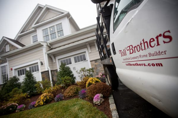 Toll Brothers Inc. signage is displayed on a truck parked in front of a model home at the company's Enclave at Rye Brook housing development in Rye Brook, New York.