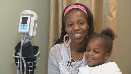 Fantasia James-Hollins and 3-year-old daughter Antalisa at the Dimock Health Center in Roxbury, Mass.