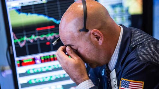 A trader works on the floor of the New York Stock Exchange during the afternoon of Aug. 20, 2015.