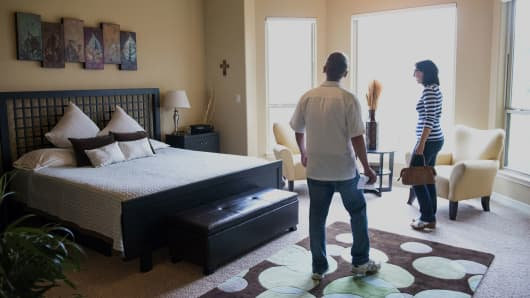 Prospective home buyers view a bedroom while touring a house for sale in Helotes, Texas, Feb. 21, 2016.