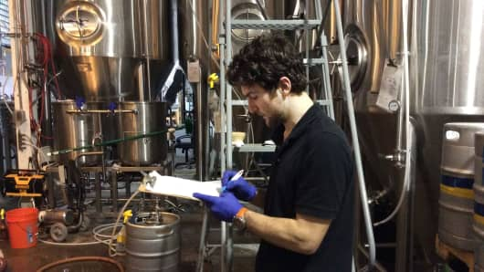 A worker at the Half Full Brewery in Stamford, Conn.