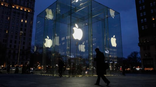 A man walks outside the Apple store on the Fifth Avenue in New York on February 17, 2016.
