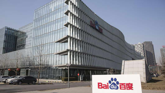 The Baidu Inc. logo is displayed outside company's headquarters in Beijing, China, on Tuesday, Jan. 19, 2016.