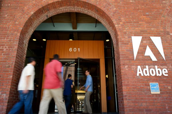 People enter the Adobe Systems Inc. office in San Francisco, California.