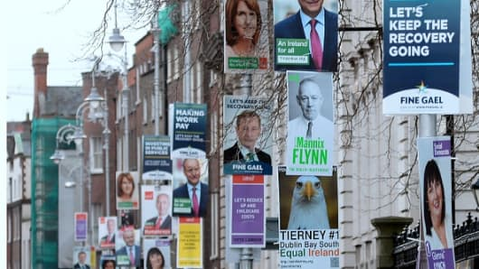 Campaign posters for the parliamentary elections on lamposts in Dublin, Ireland, on February 21, 2016.