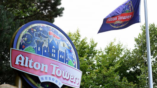 A logo sits outside the entrance to Alton Towers theme park, in Staffordshire, UK.
