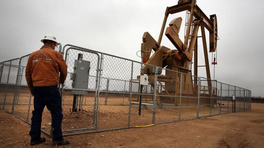 An oil well owned and operated by Apache Corporation in the Permian Basin, viewed on February 5, 2015 in Garden City, Texas.