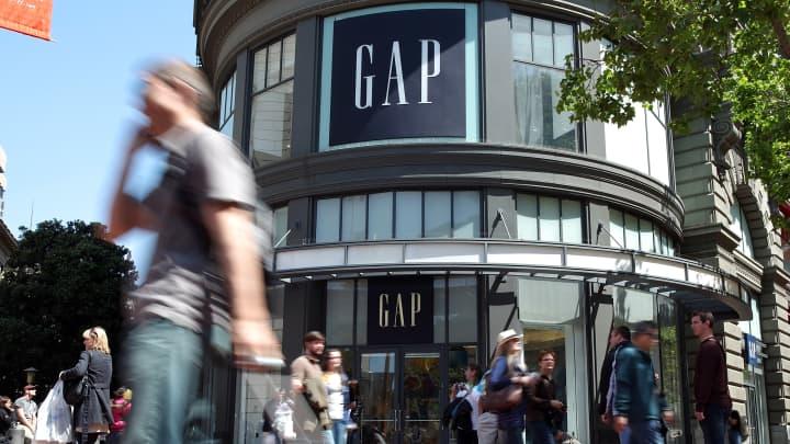 Pedestrians walk by a Gap store in San Francisco, California.