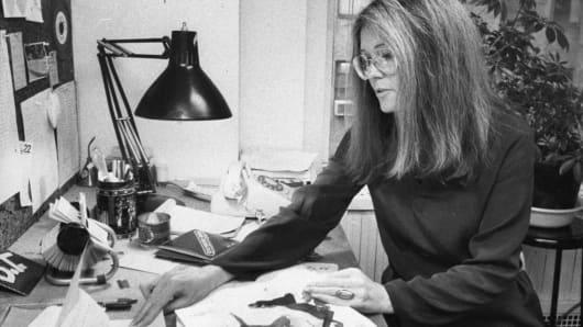 Gloria Steinem, feminist leader and founder of 'Ms.' magazine, at her desk.