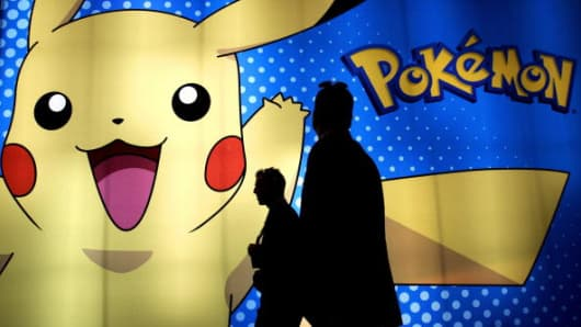 Members of the trade walks past the 'Pokemon' booth