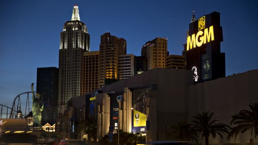 Vehicles drive past the New York-New York Hotel & Casino, left, and MGM Resorts International Grand Hotel & Casino in Las Vegas, Nevada.