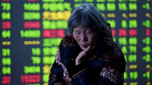An investor reacts in front of the screen at an exchange hall on February 25, 2016 in Hangzhou, Zhejiang Province of China.