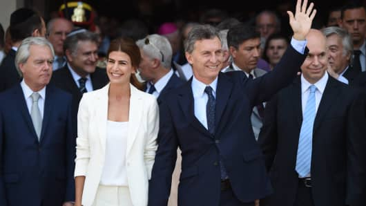 Argentina's President Mauricio Macri (R) and his wife, first lady Juliana Awada leave the Metropolitan Cathedral after attending a Te Deum in Buenos Aires on December 11, 2015.