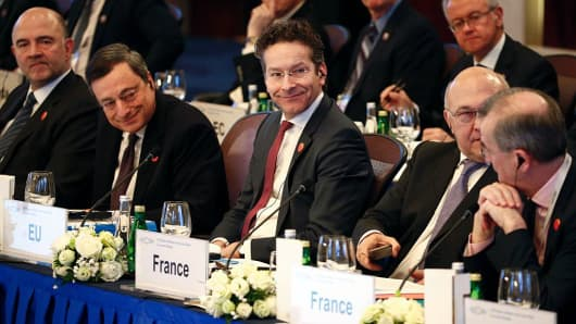 (L-R) European Union Economic and Financial Affairs, Taxation and Customs Commissioner Pierre Moscovici, European Central Bank President Mario Draghi, Eurogroup President Jeroen Dijsselbloem, French Finance Minister Michel Sapin (partly hidden) attend the G20 Finance Minister