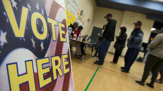 People arrive to vote in the South Carolina Democratic primary in Columbia, South Carolina, on February 27, 2016.