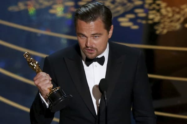 "Leonardo DiCaprio accepts the Oscar for Best Actor for the movie ""The Revenant"" at the 88th Academy Awards in Hollywood, California February 28, 2016."