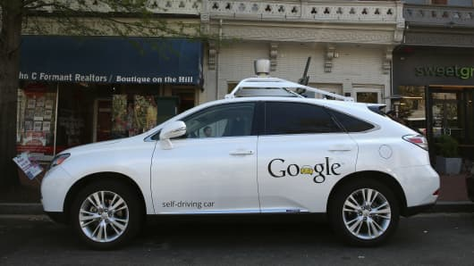 Googles Lexus RX 450H Self Driving Car is seen parked on Pennsylvania Ave. on April 23, 2014 in Washington, DC. A Google self-driving car caused its first crash on February 14, when it changed lanes and put itself in the path of an oncoming bus.
