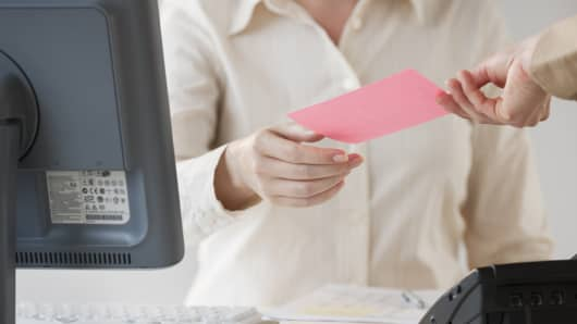 Employee receives a pink slip at work.