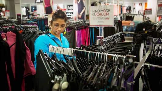 A shopper browses clothing at a JC Penney store in Queens, New York.
