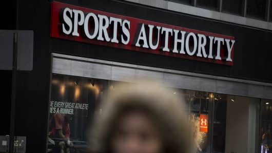 A pedestrian walks past a Sports Authority Inc. store in New York, U.S., on Saturday, Feb. 6, 2016. Sports Authority, once the biggest sporting-goods chain in the U.S., is preparing to file for bankruptcy.