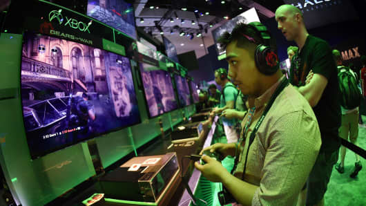 tests a new 'Gears of War' game at the Xbox display on the second day of the Electronic Entertainment Expo, known as E3 at the Convention Center in Los Angeles, California on June 17, 2015.