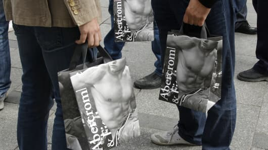 Abercrombie & Fitch bags held by shoppers