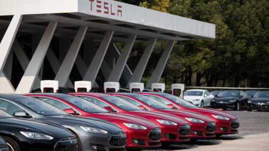 Tesla Model S vehicles parked outside a car dealership in Shanghai.