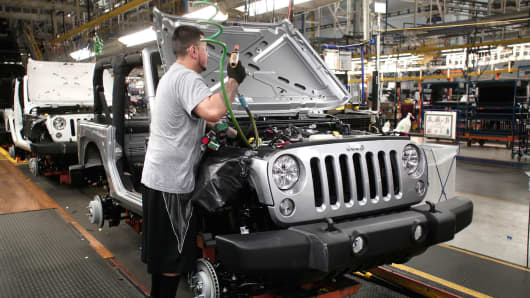 A worker assembles a Jeep Wrangler at the Chrysler Toledo North Assembly Plant in Toledo, Ohio.