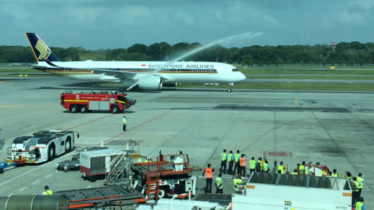 Singapore Airlines' new A350-900 is given a water-cannon salute as it rolls onto the tarmac at Changi Airport.