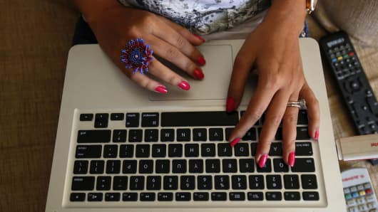 Blogger typing on a computer