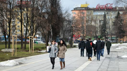 Locals and tourist walk through the grounds of the National Palace of Culture on January 31, 2016 in Sofia, Bulgaria.