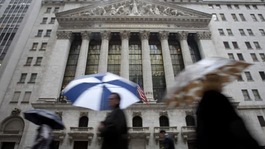 Pedestrians pass in front of the exterior of the New York Stock Exchange (NYSE) in New York.