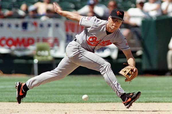 Cal Ripken Jr. stretches to reach a ground ball during a game in 1997
