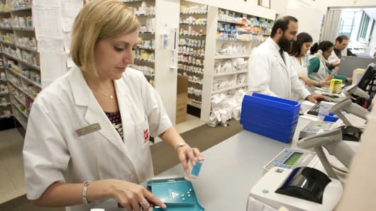 Pharmacy manager prepares a prescription at a Walgreens store.