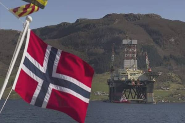 Norway taps oil fund for the first time