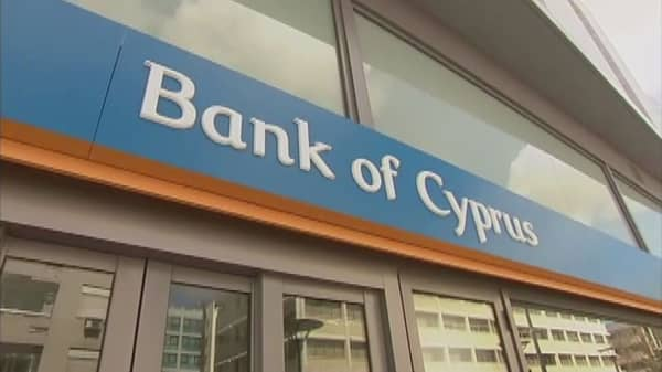 Cyprus exits bailout with cash to spare