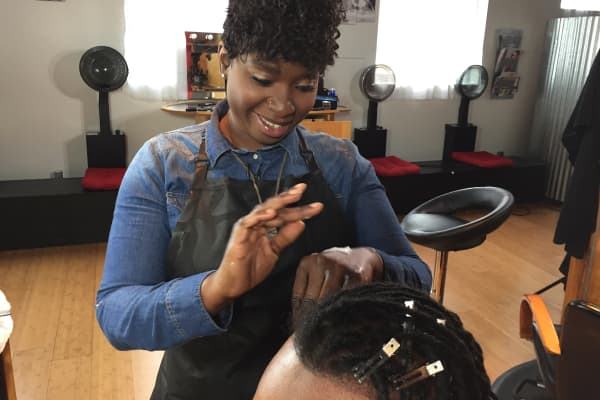 Aicheria Bell is taking on hair-braiding licensing laws in Iowa.
