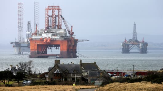 The West Phoenix oil platform, operated by Seadrill Norge AS, center, stands in the Port of Cromarty Firth in Cromarty, U.K.