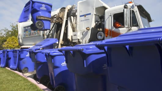 A City Of San Diego's Environmental Services Department truck empties recycling bins.