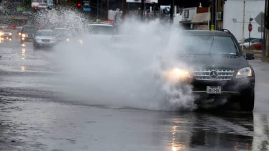 The morning commute on Lankershim Boulevard in Studio City, California, as drivers navigate large puddles of water from a passing storm on March 7, 2016.