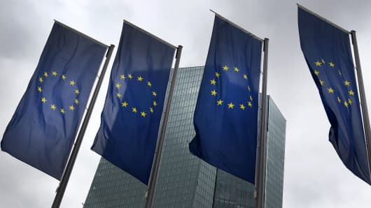 European flags flutter in front of the headquarters of the European Central Bank (ECB) in Frankfurt am Main, western Germany