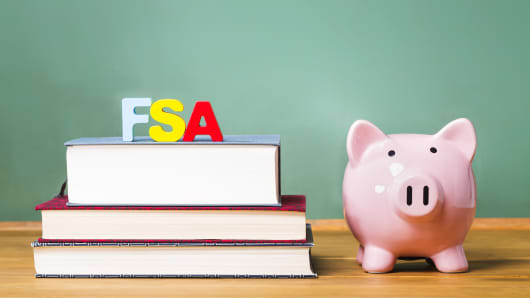 Federal Student Aid theme with textbooks and piggy bank