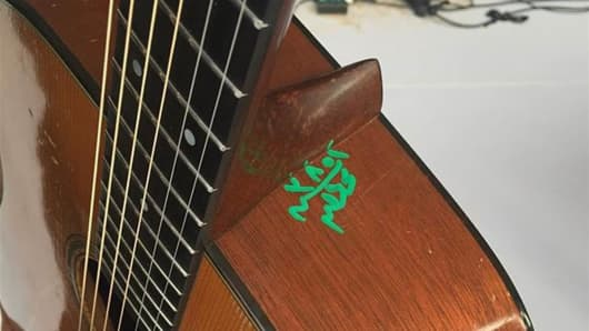 Bryan Adams vintage guitar defaced by Cairo airport officials.