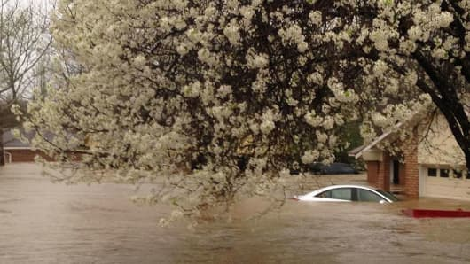 A car lies submerged in the Tall Timbers subdivision after flooding near Shreveport, Louisiana.