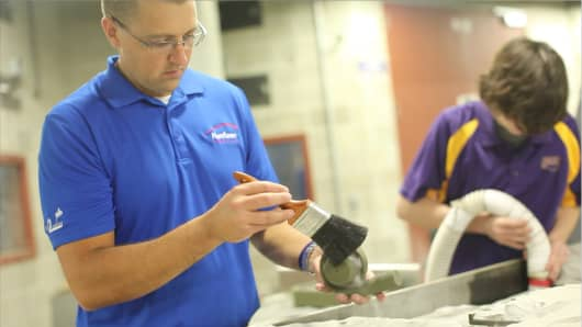 Brandon Lamoncha of Humtown Products in Columbiana, Ohio, works with University of Northern Iowa students to accelerate the adoption of additive manufacturing.